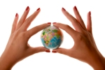 Womans hands holding small world Globe Planet Business
